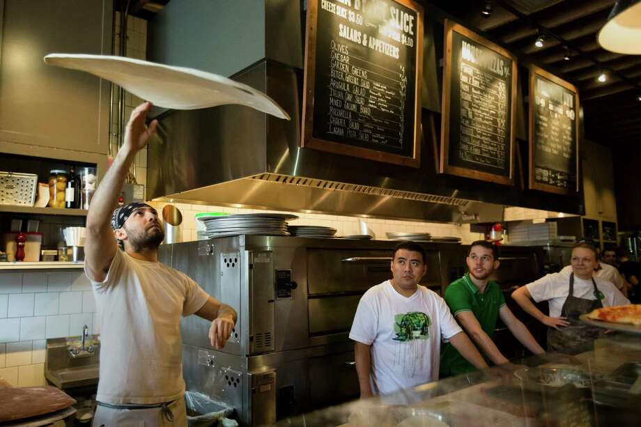"Israel Santiago locks in his win for ""speedy speed"" and best looking pizza during the ""Toss Like a Boss"" event Sunday at the Ballard Pizza Co. in Seattle.  Photo: JORDAN STEAD / SEATTLEPI.COM"