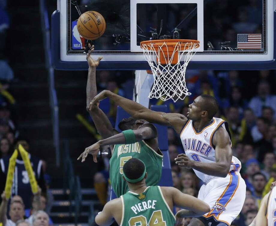 Thunder forward Serge Ibaka (right) blocks Kevin Garnett's shot attempt during Oklahoma City's 91-79 victory over the Celtics. Photo: Sue Ogrocki / Associated Press