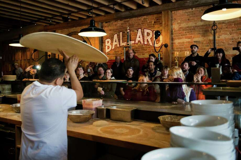 """Pizza Boss King"" Oscar Guererro spins his dough during ""Toss Like a Bos."" Photo: JORDAN STEAD / SEATTLEPI.COM"