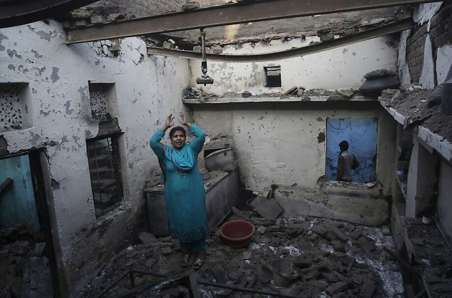 A Pakistani Christian woman reacts after her home was damaged by an angry Muslim mob in Lahore, Pakistan, Sunday, March 10, 2013. Hundreds of Christians clashed with police in eastern and southern Pakistan on Sunday, a day after a Muslim mob burned dozens of homes owned by members of the minority religious group in retaliation for alleged insults against Islam's Prophet Muhammad.  Photo: K.M. Chaudary, Associated Press