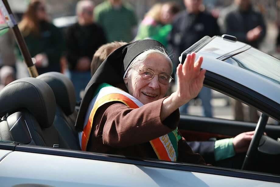 Grand Marshal Sister Mary Trinity Kenny waves along the parade route during the 32nd Bergen County St. Patrick's Day Parade, Sunday, March 10, 2013 in Bergenfield, N.J.  Photo: Chris Pedota, Associated Press