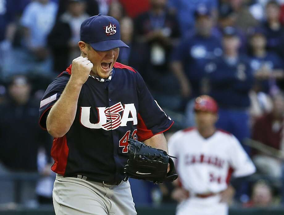 United States' Craig Kimbrel shouts and pumps his fist as Canada coach Tim Leiper puts his hands on his hips after the final out is recorded in the ninth inning for a United States win during a World Baseball Classic baseball game on Sunday, March 10, 2013, in Phoenix.  The United States defeated Canada 9-4.  Photo: Ross D. Franklin, Associated Press