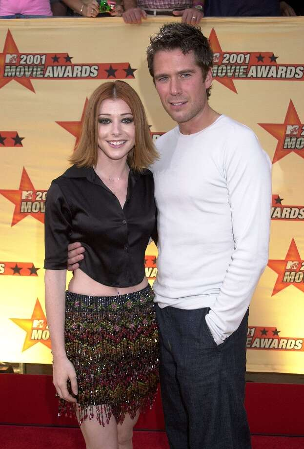 Alexis Denisof was Buffy's second watcher, Wesley, a character he also played on the Buffy spin-off Angel. He and wife Alyson Hannigan are seen here in 2001. Photo: Gregg DeGuire, WireImage / WireImage