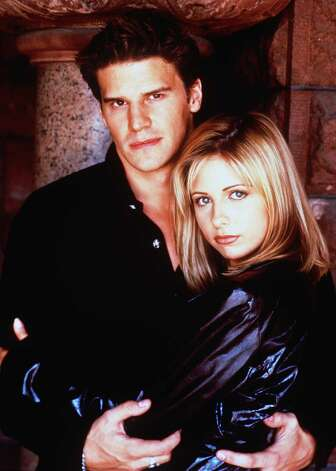 Buffy and Angel (Sarah Michelle Gellar and David Boreanaz). The Slayer falls in love with a vampire who's cursed with a soul. They sleep together, he turns evil (true moment of happiness and all) and bam. All hell breaks loose. Photo: Twentieth Century Fox, Getty Images / Getty Images North America