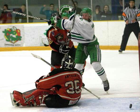 The Whalers' Richard Vanderhoek, right, puts a rebound past Thousand Islands goalie Matt Anthony during the Federal Hockey League playoff semifinal game Sunday night, Mar. 10, 2013, at the Danbury Arena. Photo: Barry Horn / The News-Times Freelance