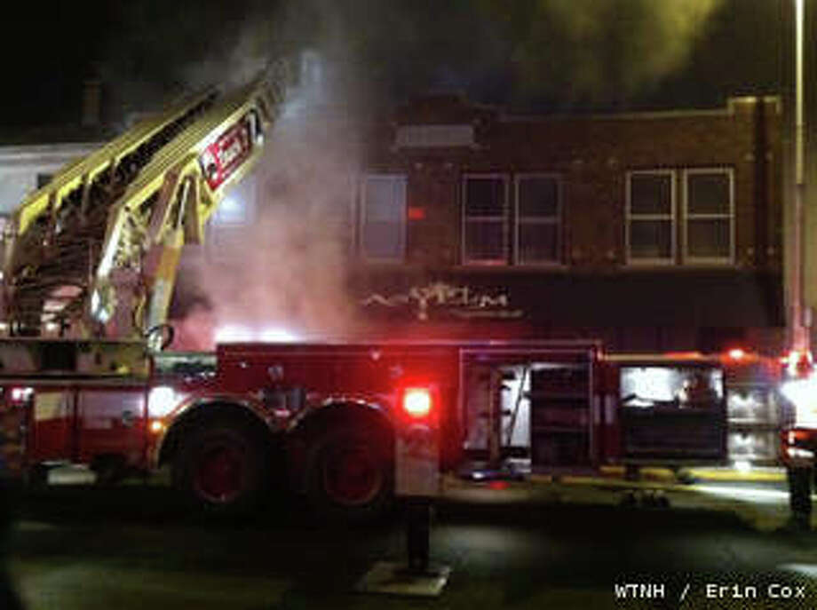 Ansonia firefighters battle an early-morning blaze on Main Street. Photo: WTNH, Wtnh / WTNH