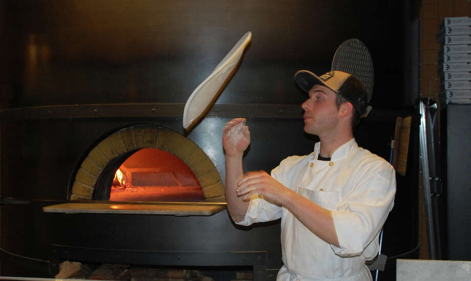 "Ian Knowles is the ""pizzaiola"" at Tarry Lodge in the Saugatuck section of town. A pizzaiola is a pizza maker -- or master. Asked Sunday, the first day of Westport Restaurant Week, what the secret to cooking great food is, Knowles said without hesitation, ""Love! ... Love!""  WESTPORT NEWS, CT 3/10/13 Photo: Jarret Liotta / Westport News contributed"