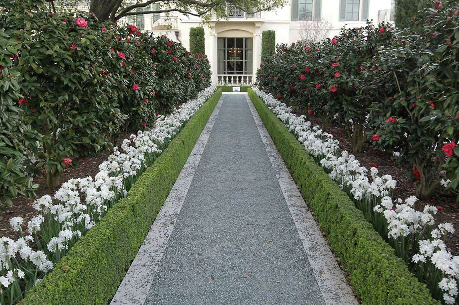 A pathway in the garden of a residence located at 1620 River Oaks Boulevard during the River Oaks Garden Club 78th Annual Azalea Saturday, March 9, 2013, in Houston. Photo: James Nielsen, Houston Chronicle / © 2013  Houston Chronicle