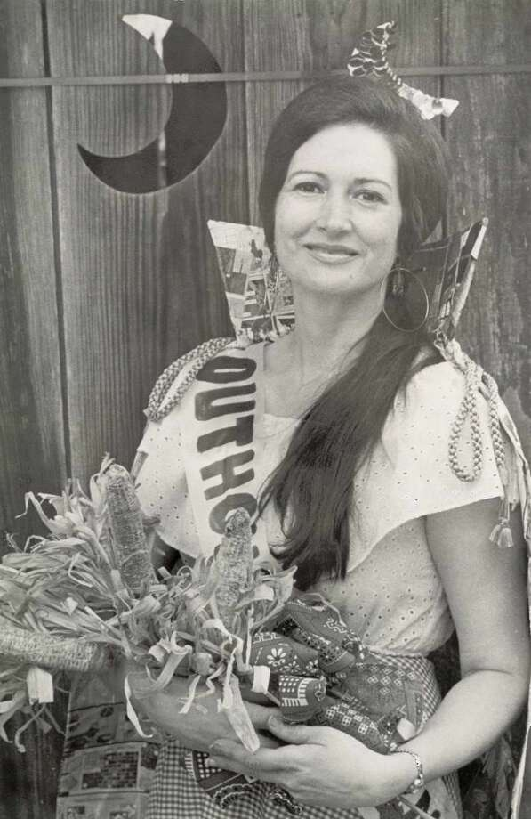 Outhouse Queen  Rosetta Premeaux holds a special corn cob bouquet after her coronation during the Nederland Heritage Festival in 1976. Photo: Archive Photo