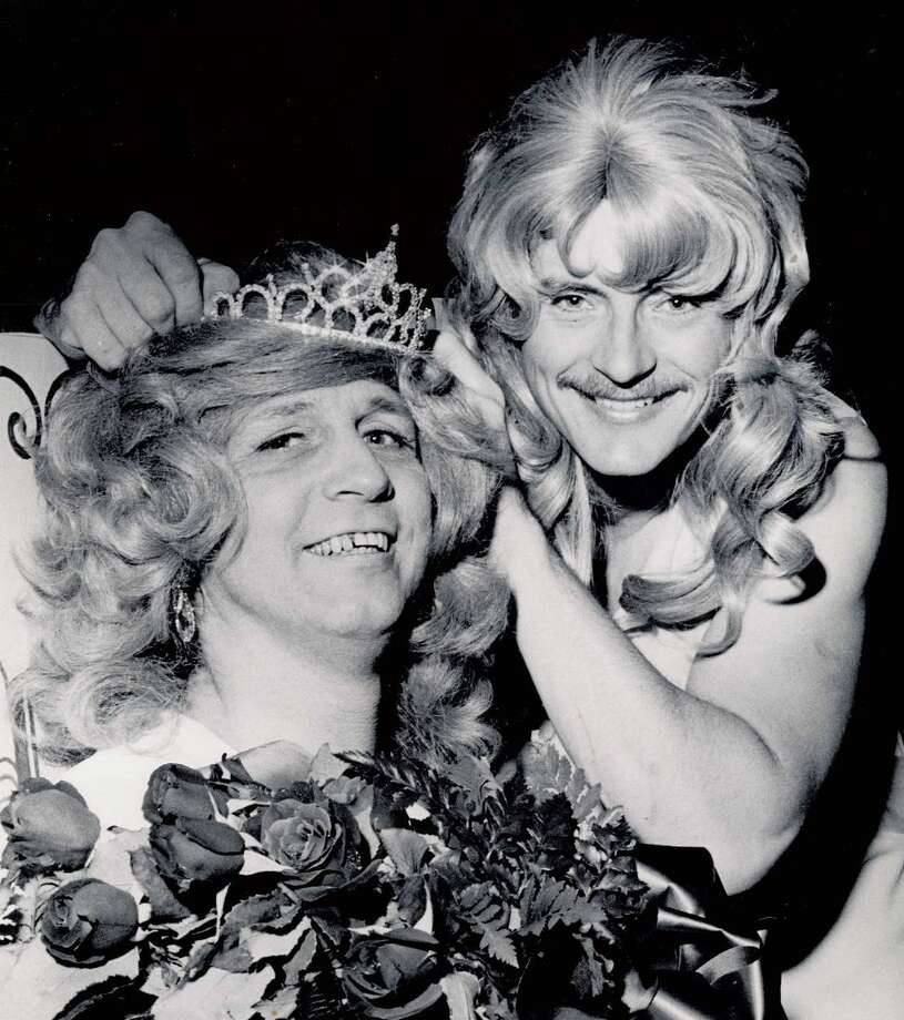 Lovely Don Wheeler, 1975 Mock Miss America, crowns new queen Bill Schroeter during the 1976 Nederland Heritage Festival. The pageant was one of many zany activities featured in the 44 year history of the festival. Photo: Archive Photo