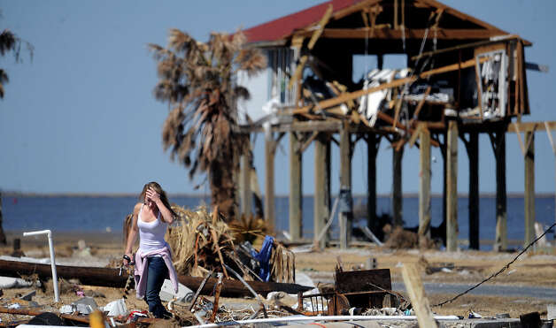 Rachel Segura surveys debris and searches for personal items swept from herBolivar home during Hurricane Ike. Enterprise file photo Photo: TAMMY MCKINLEY / Beaumont