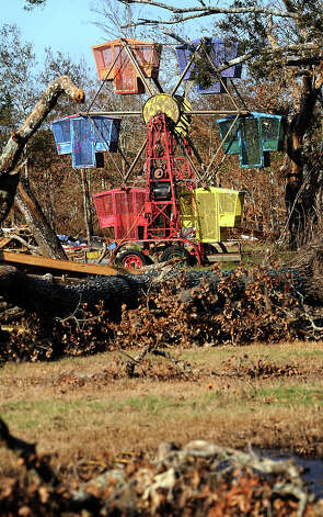 A carnival ride sits among other debris left behind by Hurricane Ike in Oak Island, Friday. Tammy McKinley/The Enterprise Photo: TAMMY MCKINLEY