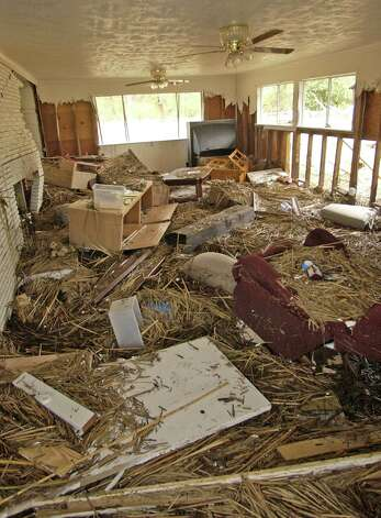 Destruction and debris in the Brookshire family home provide a glimpse at the power of Ike's storm surge. Dave Ryan