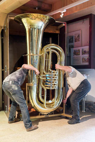 Musical instrument craftsmen Michael Geilert and Hartmut Geilert load the world's largest functional tuba in a case at the Musikinstrumenten-Museum on March 8, 2013 in Markneukirchen, Germany. The tuba is exactly double the dimensions in every respect to a normal tuba, and twenty local artisans crafted it in 2010 as part of celebrations around the town's 650th anniversary. The tuba will soon travel to Frankfurt, where it will be displayed at the 2013 Music Trade Fair. Markneukirchen has a rich tradition of brass and wood musical instrument manufacture dating back to the 17th century. Photo: Joern Haufe, Getty Images / 2013 Getty Images