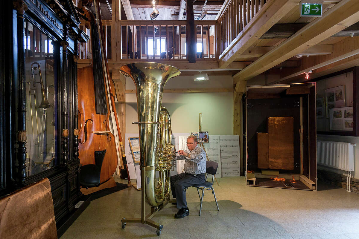 Musical instrument craftsman Manfred Paulus adjusts the valves of world's largest functional tuba at the Musikinstrumenten-Museum on March 8, 2013 in Markneukirchen, Germany. The tuba is exactly double the dimensions in every respect to a normal tuba, and twenty local artisans crafted it in 2010 as part of celebrations around the town's 650th anniversary. The tuba will soon travel to Frankfurt, where it will be displayed at the 2013 Music Trade Fair. Markneukirchen has a rich tradition of brass and wood musical instrument manufacture dating back to the 17th century.