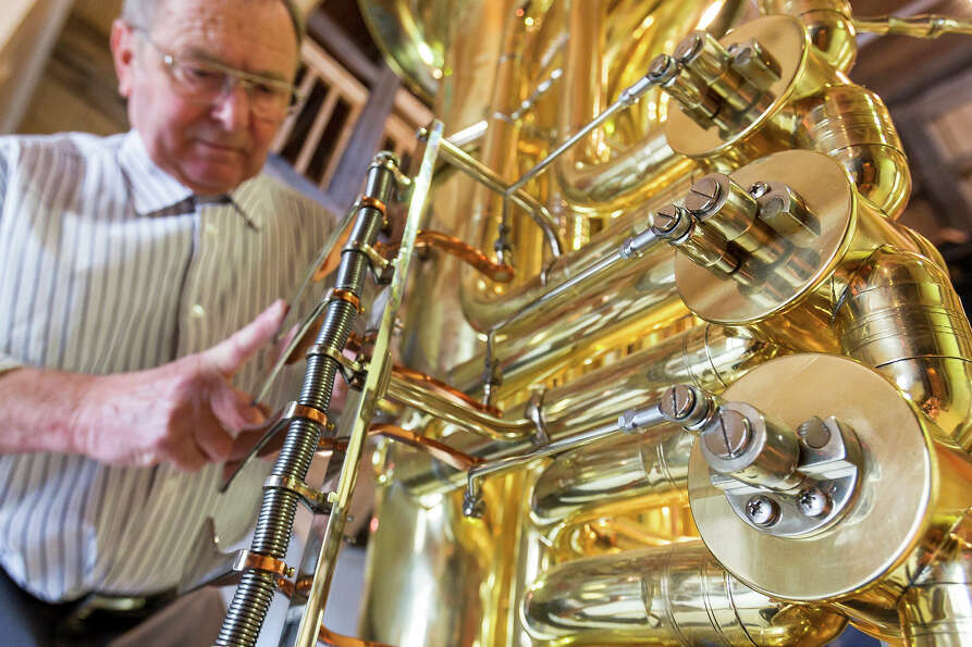 Musical instrument craftsman Manfred Paulus adjusts the valves of world's largest functional tuba at