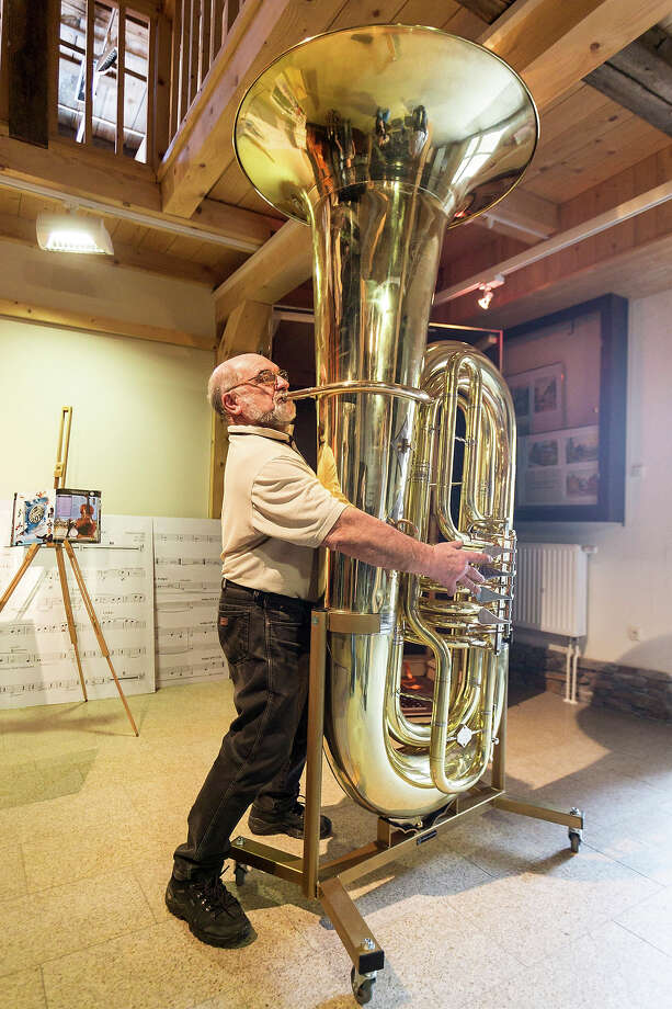 Musical instrument craftsman Hartmut Geilert demonstrates how to play the world's largest functional tuba at the Musikinstrumenten-Museum on March 8, 2013 in Markneukirchen, Germany. Photo: Joern Haufe, Getty Images / 2013 Getty Images