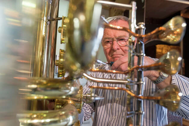 Musical instrument craftsman Manfred Paulus adjusts the valves of world's largest functional tuba at the Musikinstrumenten-Museum on March 8, 2013 in Markneukirchen, Germany. The tuba is exactly double the dimensions in every respect to a normal tuba, and twenty local artisans crafted it in 2010 as part of celebrations around the town's 650th anniversary. The tuba will soon travel to Frankfurt, where it will be displayed at the 2013 Music Trade Fair. Markneukirchen has a rich tradition of brass and wood musical instrument manufacture dating back to the 17th century. Photo: Joern Haufe, Getty Images / 2013 Getty Images