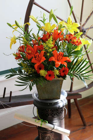 Linda Paolini's design is displayed at the NGC Small Standard Flower Show at the Pinkney Museum in Rowayton, Conn. on Sunday, March 10, 2013. The Rowayton Gardeners presented the show with arrangements inspired by the Rowayton Historical Society. Photo: BK Angeletti, B.K. Angeletti / Connecticut Post freelance B.K. Angeletti