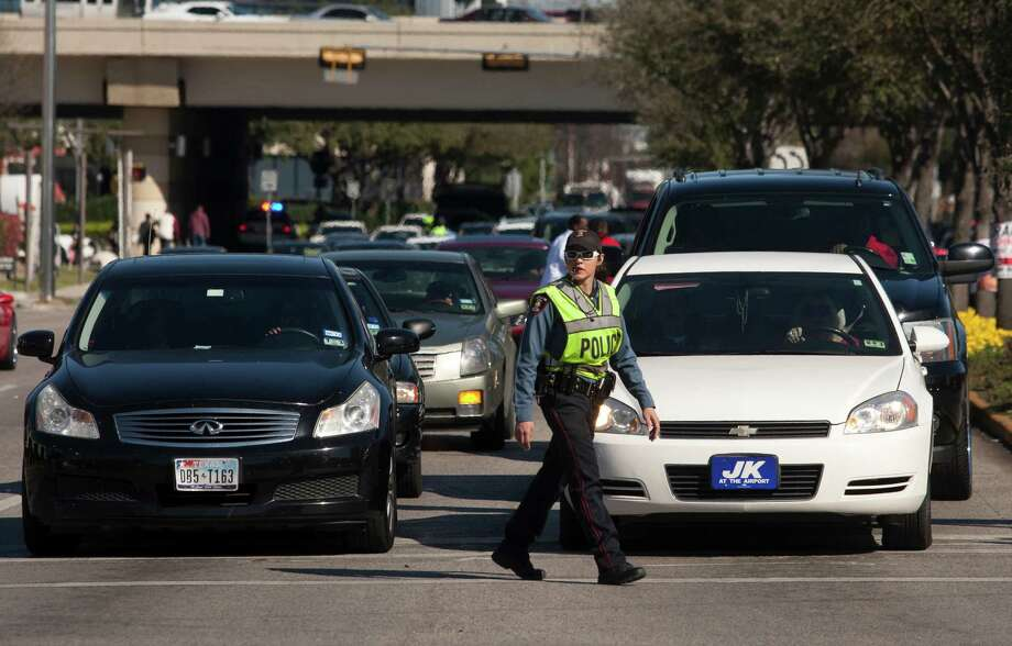 Houston ISD Police Officer Yuri Saenz directs traffic at the Galleria on Saturday, Feb. 16, 2013, during the NBA All Star game. ( J. Patric Schneider / For the Chronicle ) Photo: J. Patric Schneider, Freelance / © 2013 Houston Chronicle