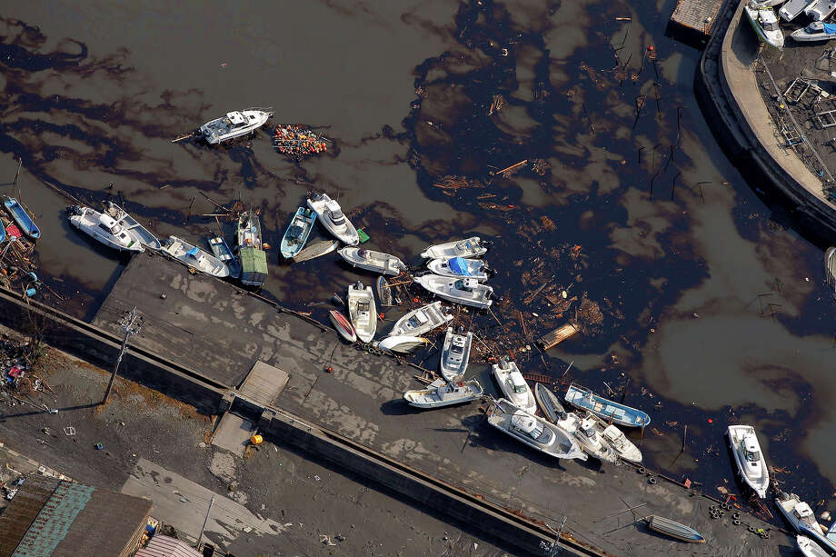 Boats get washed away by floods in Sendai, northern Japan, Saturday, March 12, 2011. Japan launched a massive military rescue operation Saturday after a giant, quake-fed tsunami killed hundreds of people and turned the northeastern coast into a swampy wasteland, while authorities braced for a possible meltdown at a nuclear reactor. (AP Photo/Itsuo Inouye) Photo: Itsuo Inouye, ASSOCIATED PRESS / AP2011