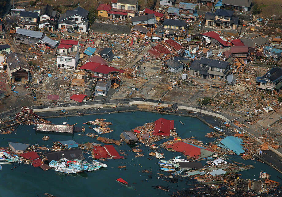 Wrecked ships, houses and debris float in the sea in Kesennuma, Miyagi Prefecture, Sunday, March 13, 2011 after Japan's biggest recorded earthquake hit its eastern coast Friday. (AP Photo/Itsuo Inouye) Photo: Itsuo Inouye, ASSOCIATED PRESS / AP2011