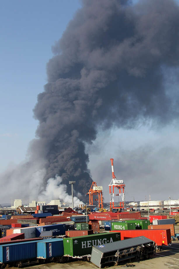Smoke billows from an oil refinery plant on fire in Sendai, northeastern Japan, Saturday, March 12, 2011, following Friday's 8.9-magnitude quake and the tsunami it spawned hit the country's northeastern coast. (AP Photo/Koji Sasahara) Photo: Koji Sasahara, ASSOCIATED PRESS / AP2011