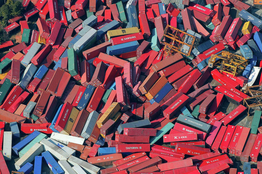 Cargo containers are strewn about in Sendai, northern Japan, Saturday, March 12, 2011. Japan launched a massive military rescue operation Saturday after a giant, earthquake-fed tsunami killed hundreds of people and turned the northeastern coast into a swampy wasteland, while authorities braced for a possible meltdown at a nuclear reactor. (AP Photo/Itsuo Inouye) Photo: Itsuo Inouye, ASSOCIATED PRESS / AP2011