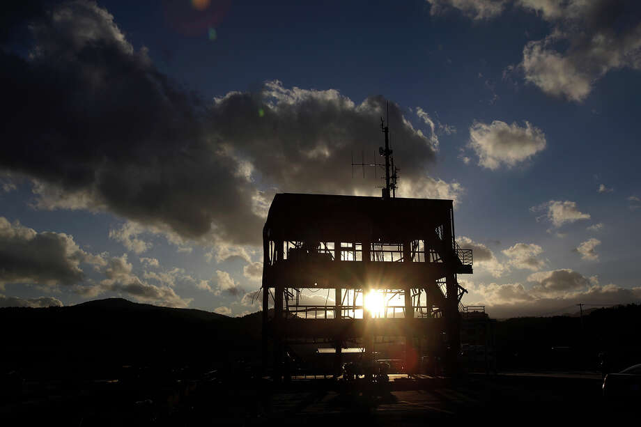 The sun sets behind the wrecked Disaster Control Center where 42 people were killed by the March 11, 2011 tsunami, in Minamisanriku, Miyagi prefecture, Sunday, March 10, 2013. Japan marks the second anniversary of the disaster on Monday. (AP Photo/Shizuo Kambayashi) Photo: Shizuo Kambayashi, ASSOCIATED PRESS / AP2013