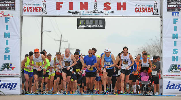 The race begins for marathoners and half marathoners during the Gusher run on Saturday.  2013 Gusher Marathon and 5K Photo taken March, 09, 2013 Guiseppe Barranco/The Enterprise Photo: Guiseppe Barranco, STAFF PHOTOGRAPHER / The Beaumont Enterprise