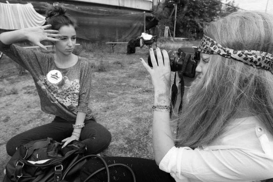 Hipster with photographer.  Photo: Adam Berry, Getty / 2012 Getty Images