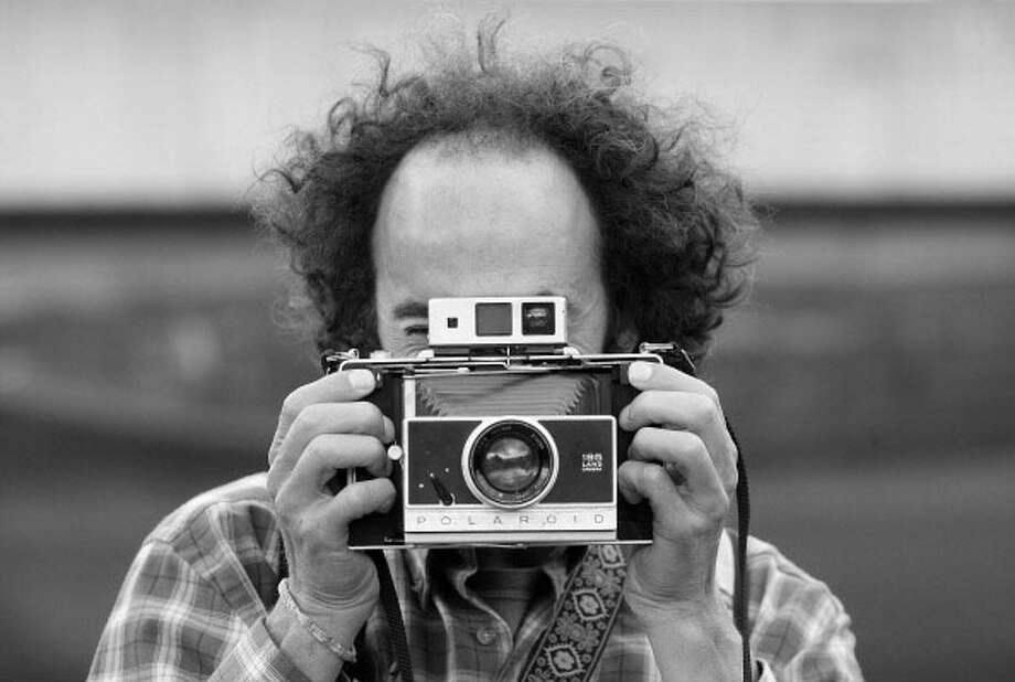 Hipster with a beatnik camera.  Photo: Adam Berry, Getty / 2012 Getty Images