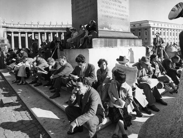 1958: Members of the public outside St Peter's in Vatican City, Rome waiting for the signal that a new Pope has been elected, 29th. Cardinal Roncalli, the Patriarch of Venice was later elected and chose the name Pope John XII. Photo: Keystone, Getty Images / 2005 Getty Images