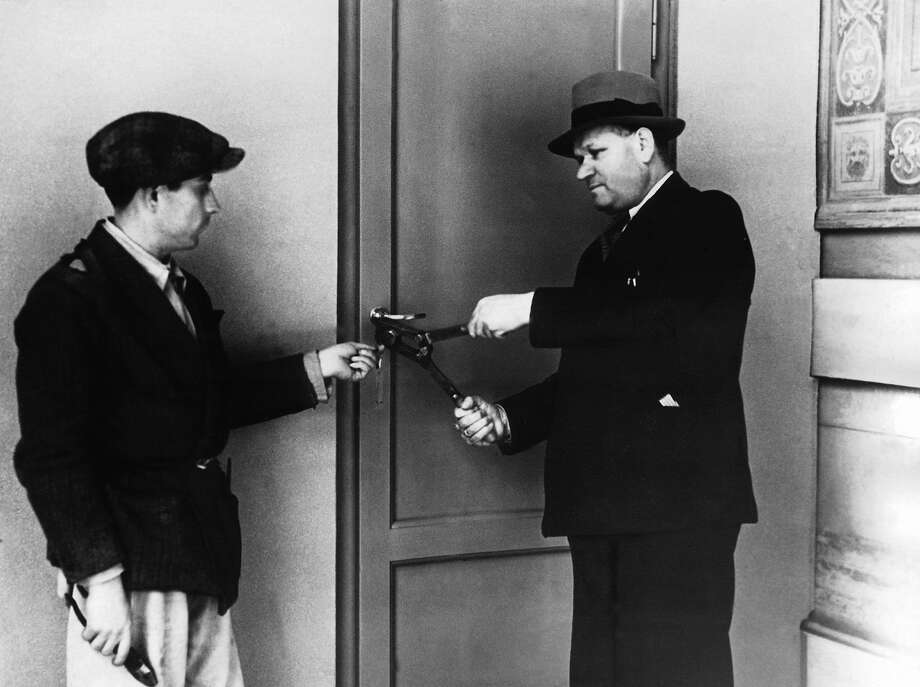 1939: In February-March 1939, employees of the Vatican affixing seals to the Vatican door where the conclave of cardinals is being held to choose a successor to Pope Pius XI. Photo: Keystone-France, Gamma-Keystone Via Getty Images / 1939 Keystone-France
