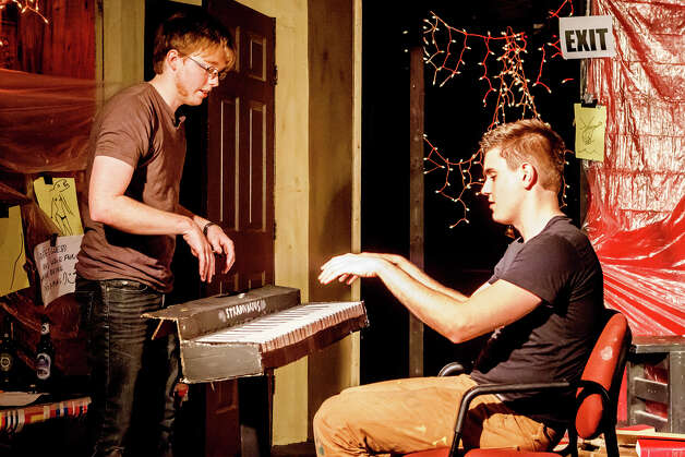 "The Aesthetic of Waste cast members Judson Rose (left) and Seth Larson in the scene ""Piano Lessons with Fitzgerald"" during their performance of ""We Stole This"" at the Overtime Theater, 1203 Camden, on Friday, March 1, 2013.  The show calls on them to produce 30 scenes in 60 minutes; each week, they write a certain number of new sketches.  MARVIN PFEIFFER/ mpfeiffer@express-news.net Photo: MARVIN PFEIFFER, Marvin Pfeiffer/ Express-News / Express-News 2013"