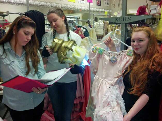 "Lizzy Emond, far left, Rachael Mathis and Delaney Davidson, all tech students at New Canaan High School, work behind the scenes for the upcoming production ""Beauty & the Beast."" Photo: Contributed"
