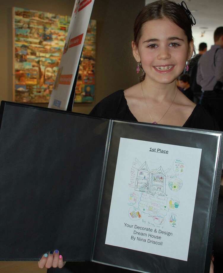 "Nina Driscoll, 8, won first place among 6- to 8-year-olds in the 2013 Toy Makers II Design Competition at the Westport Arts Center. Nina designed a ""Decorate and Design Dream House,"" with interchangeable parts. WESTPORT NEWS, CT 3/10/13 Photo: Jarret Liotta / Westport News"