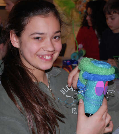 "Hannah Eldh, 12, of Westport, shows off her work Sunday from WACky Day at the Westport Arts Center: ""I think it's really fun,"" she said. WESTPORT NEWS, CT 3/10/13 Photo: Jarret Liotta / Westport News contributed"