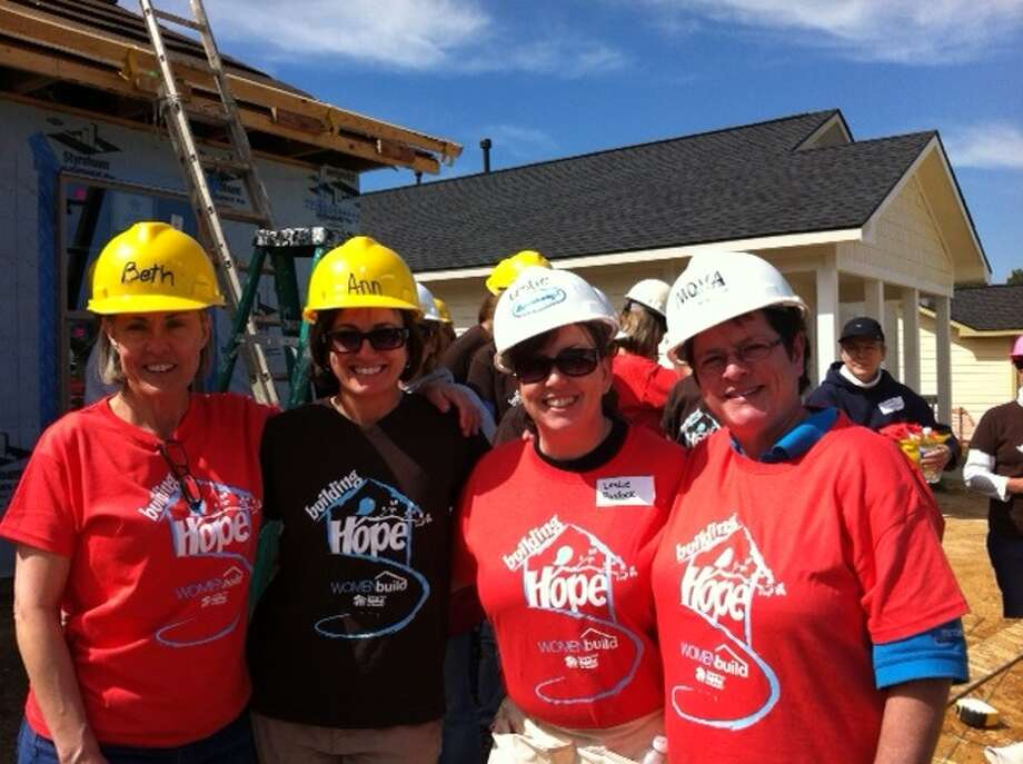 St. Anthony of Padua staff members work with the Montgomery County Habitat for Humanity, including, from left, Beth Balsam, religion teacher; Ann Pearson, middle school math teacher; Leslie Pavlock, school nurse; and Mona Rodriguez, preK3 assistant.
