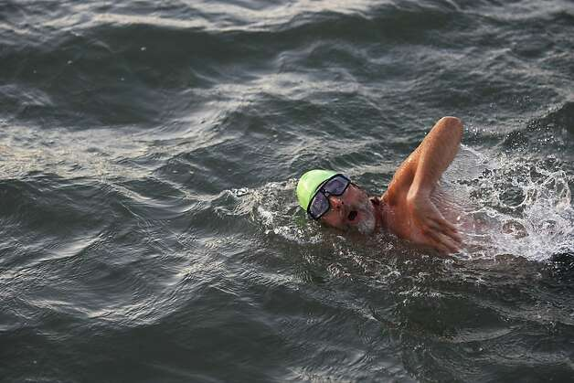 "Perez, whose first swim of the day is at 5:15 a.m., says of the frigid bay: ""You've got to will yourself in there."" Photo: James Tensuan, The Chronicle"