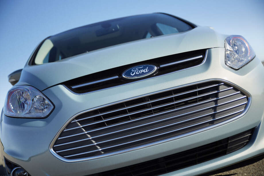 2013 Ford C-MAX Hybrid. That grille pays homage to the Aston Martin, a premiere brand once owned by Ford. / © 2012 Ford Motor Company