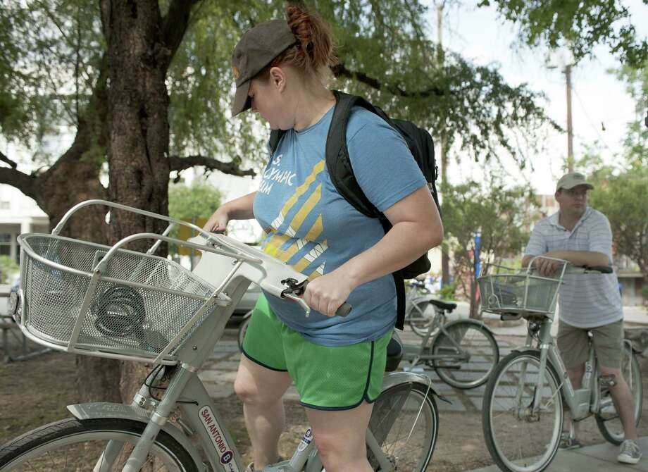 Riders prepare to ride B-cycle bicycles from the Blue Star Arts Complex station. The city is planning to add up to six B-cycle stations to between Missions Conception and Espada. Photo: San Antonio Express-News File Photo