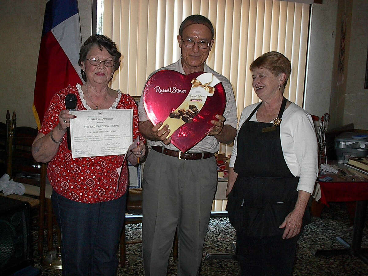NARFE Chapter 1594 President Joyce Zerr presents a gift to Ted and Vandora Chapa, owners of the Pecan Grill Restaurant, site of the group's recent convention.
