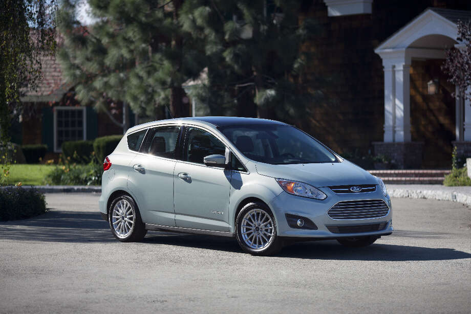 The 2013 Ford C-MAX Hybrid. Ford is now offering what is essentially a bulked-up Focus, but with a hybrid drive train. It's called the C-Max and, when you come down to it, it functions pretty well as an all-around people-and-things hauler, but it will not win any beauty contests. / © 2012 Ford Motor Company