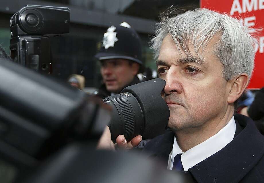 Ready for your closeup, Minister? Former British energy minister Chris Huhne bumps into a photographer outside Southwark Crown Court in London. Huhne and his ex-wife, Vicky Pryce, were expected to receive jail sentences for lying about his speeding penalty points. Photo: Justin Tallis, AFP/Getty Images