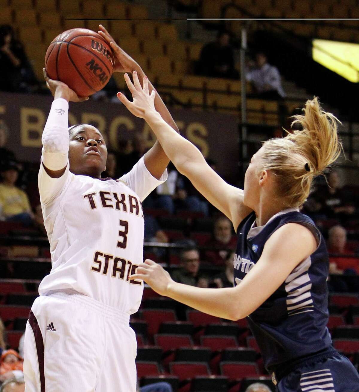 FOR SPORTS - Texas State's Diamond Ford gets a shot off against the Utah State defense during first half action at Strahan Coliseum in San Marcos on Thursday, March 7, 2013. MICHAEL MILLER / FOR THE EXPRESS-NEWS