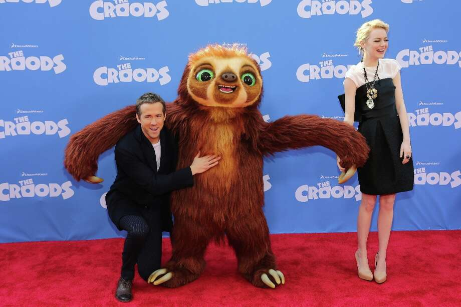 Actors Ryan Reynolds (L) and Emma Stone attend The Croods premiere at AMC Loews Lincoln Square 13 theater on March 10, 2013 in New York City. Photo: Neilson Barnard, Getty Images / 2013 Getty Images
