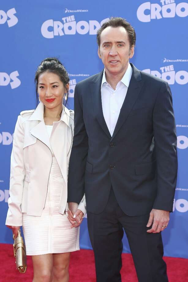 Actor Nicolas Cage and Alice Kim attend The Croods premiere at AMC Loews Lincoln Square 13 theater on March 10, 2013 in New York City. Photo: Neilson Barnard, Getty Images / 2013 Getty Images