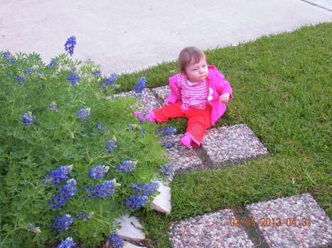 A pretty girl and her flowers in Manvel (J. Wesley/Reader submission) Photo: Reader Photo