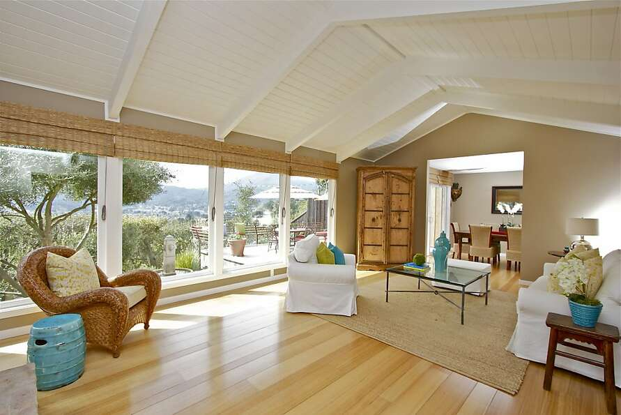 The Greenbrae home features hardwood floors and beamed ceilings.